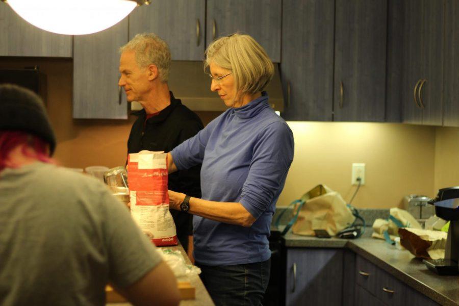 Madeline Golderg, '20, John LoGiudice and Professor Kathleen LoGiudice making pie in Messa. Photo by Kwesi Blankson.