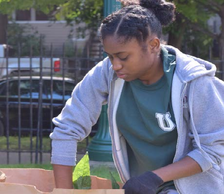 Green Grant recipient Kayla Quarless '21 working in the Octopus's Garden, which she will support with her grant. Photo by Katarina Zahedi.