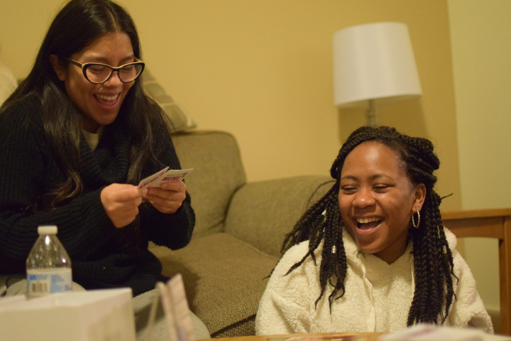 """Nicole Pulla '19 (L) and BSU co-president Jennifer Duran '20 (R) playing, """"What do you Meme?"""". Photo by Alex Appel."""