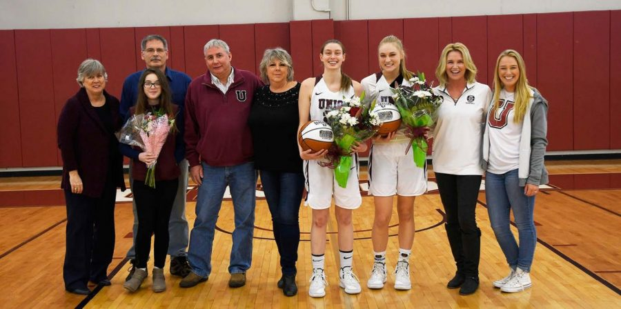 Sophie+Borg+%E2%80%9919+and+Nicole+Conley+%E2%80%9919+with+their+families.+Photo+courtesy+Ross+Ladue.