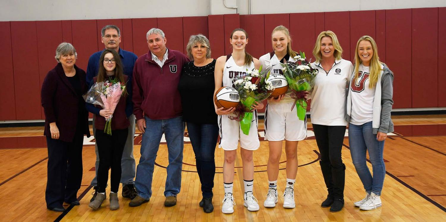 Sophie Borg '19 and Nicole Conley '19 with their families. Photo courtesy Ross Ladue.