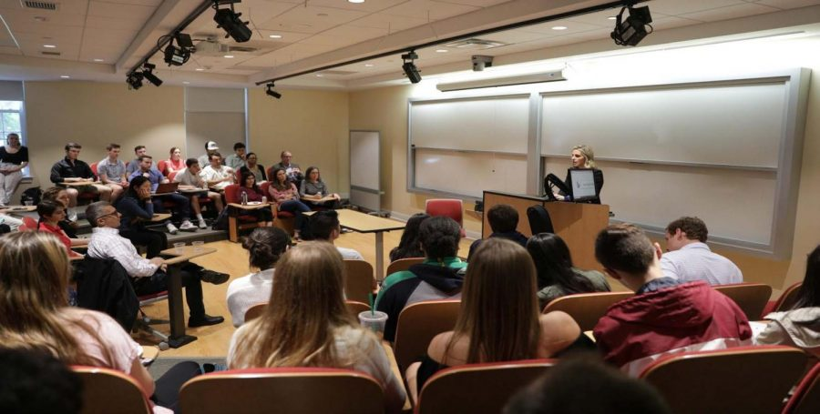 Laura Pontius '04 presents in front of staff and students in the Karp lecture theater. Image by John Jiang.