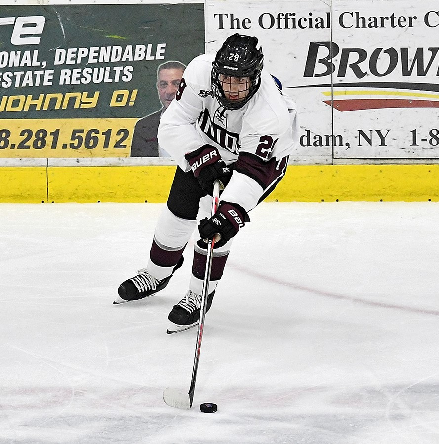 Sean Harrison '21 passing the puck. Photo courtesy of Ross Ladue.